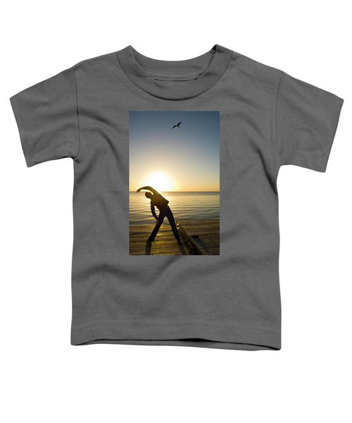 A Person Practices Yoga At The Waters Toddler T-Shirt