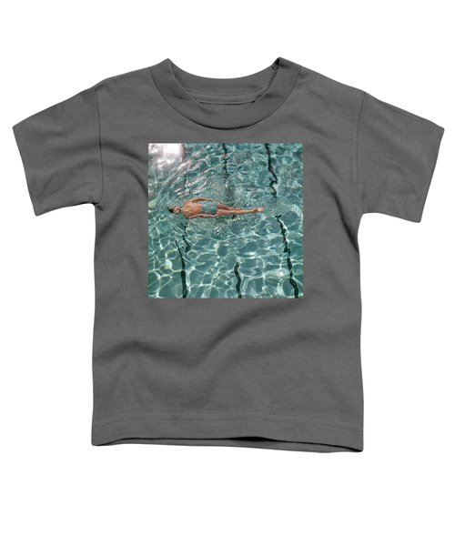 A Woman Swimming In A Pool Toddler T-Shirt