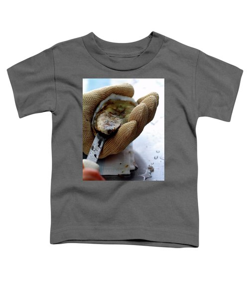 An Oytser Being Shucked Toddler T-Shirt