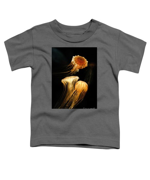 Jellyfish Trio Floating Against A Black Toddler T-Shirt