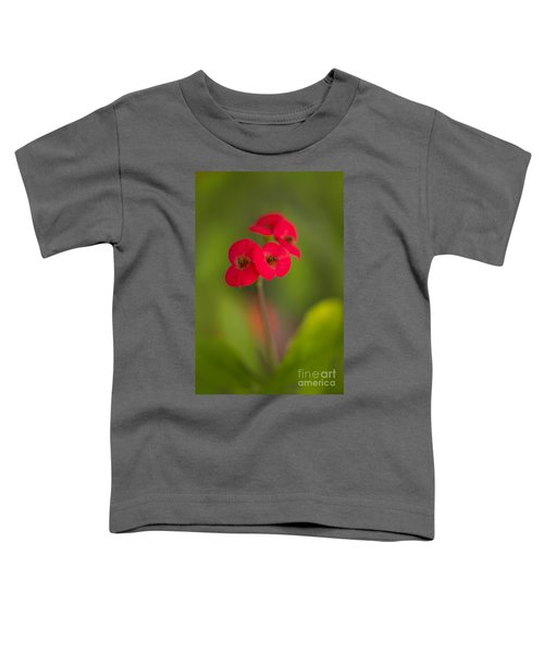 Toddler T-Shirt featuring the photograph Small Red Flowers With Blurry Background by Jaroslaw Blaminsky