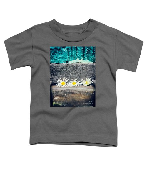 Toddler T-Shirt featuring the photograph Three Daisies Stuck In A Door by Silvia Ganora