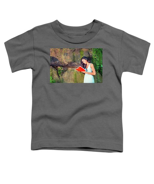 Young American Woman Reading Book At Central Park, New York, In  Toddler T-Shirt