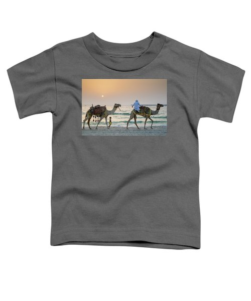 A Little Boy Stares In Amazement At A Camel Riding On Marina Beach In Dubai, United Arab Emirates Toddler T-Shirt