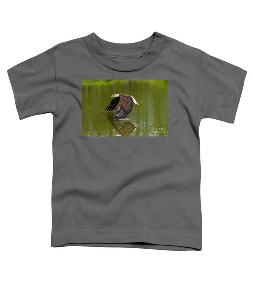 Bald Eagle In Low Flight Over A Lake Toddler T-Shirt