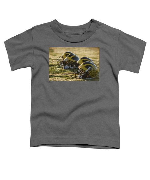 Helmets On The Field At Dawn Toddler T-Shirt