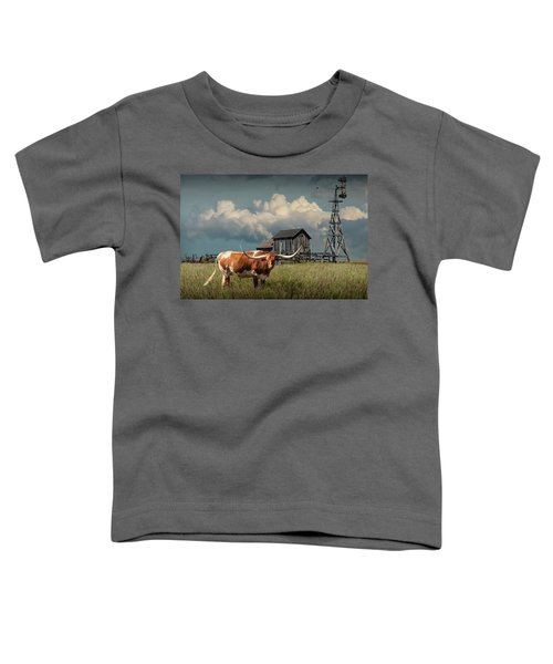 Longhorn Steer In A Prairie Pasture By Windmill And Old Gray Wooden Barn Toddler T-Shirt