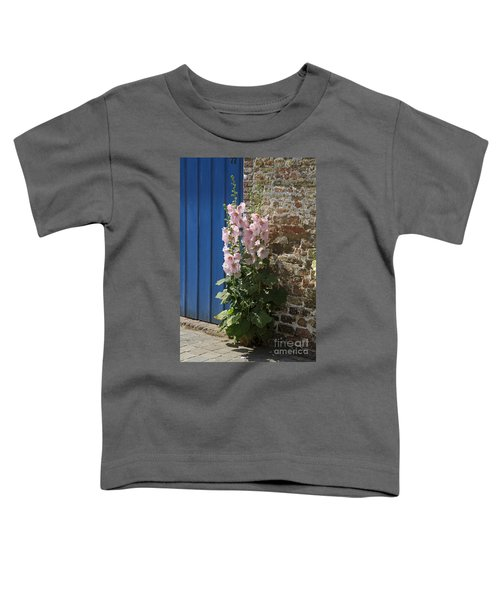 Pink Hollyhocks Growing From A Crack In The Pavement Toddler T-Shirt