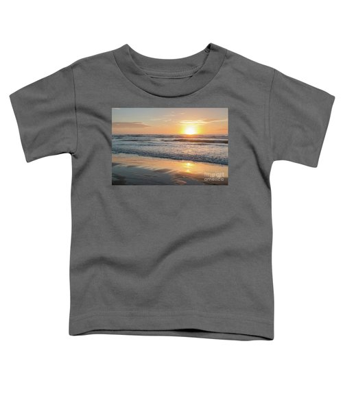 Rising Sun Reflecting On Wet Sand With Calm Ocean Waves In The B Toddler T-Shirt