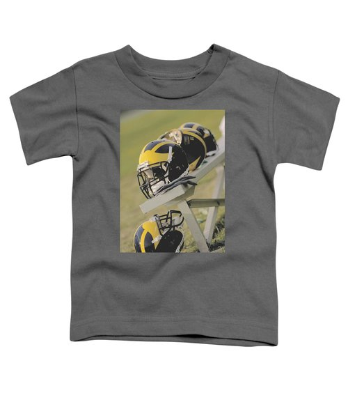 Wolverine Helmets On A Football Bench Toddler T-Shirt