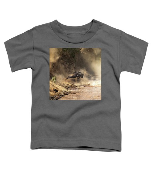 Wildebeest Leaps From The Bank Of The Mara River Toddler T-Shirt