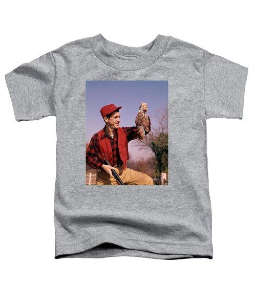 1960s Man Hunter Shotgun Holding Bagged Toddler T-Shirt
