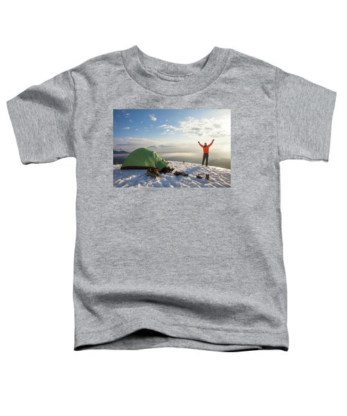 A Camper Lifts His Hand In The Air Toddler T-Shirt