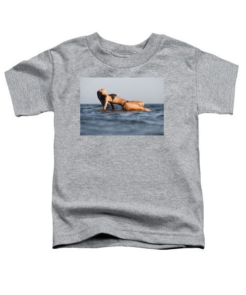 Woman Lying On The Water Toddler T-Shirt