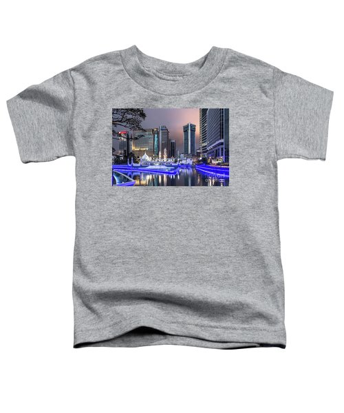 The Office Buildings Reflects In The Water Of The Klang River In Toddler T-Shirt