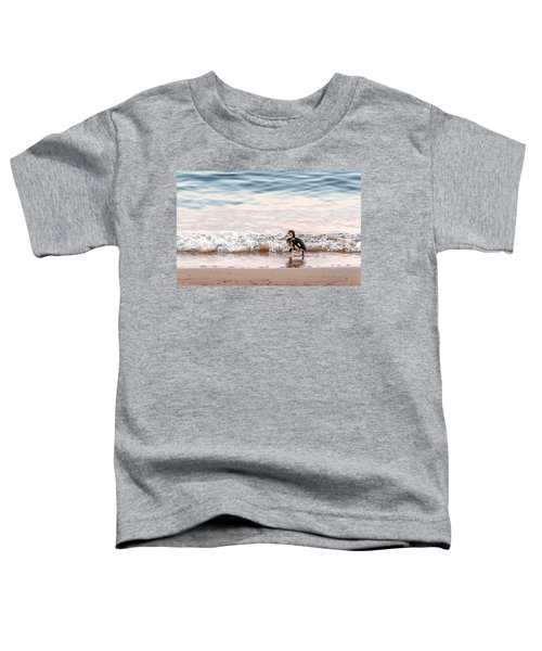 Baby Duck Running On A Beach Into The Waves Toddler T-Shirt