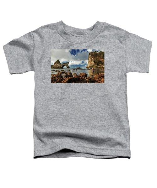 catching fish in Atuh beach Toddler T-Shirt