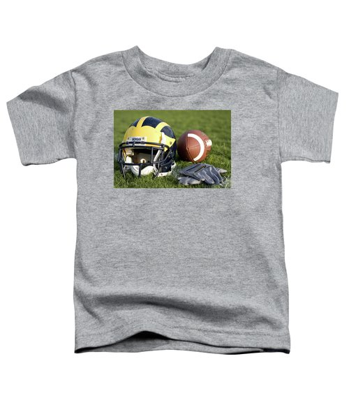 Helmet On The Field With Football And Gloves Toddler T-Shirt