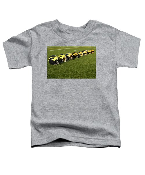Helmets Of Different Eras On The Field Toddler T-Shirt