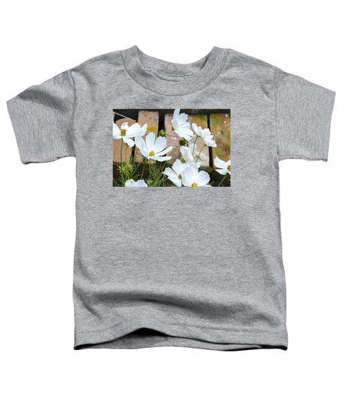 White Flowers Against Bricks Toddler T-Shirt