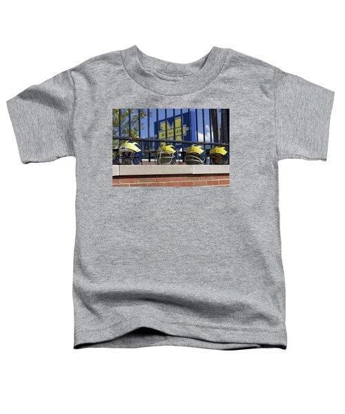 Wolverine Helmets Of Different Eras On Stadium Wall Toddler T-Shirt