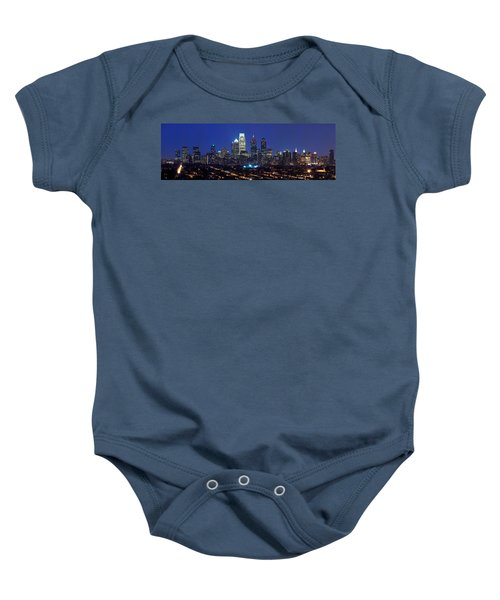 Buildings Lit Up At Night In A City Baby Onesie by Panoramic Images