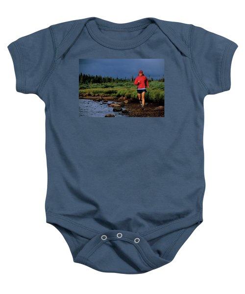 A Woman Trail Runs At Brainard Lake Baby Onesie