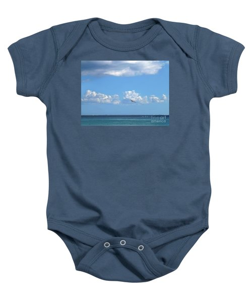 Baby Onesie featuring the photograph Flying By The Sea by Francesca Mackenney