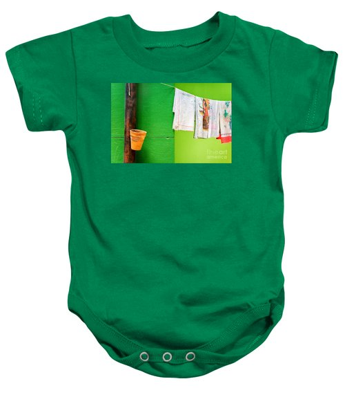 Baby Onesie featuring the photograph Vase Towels And Green Wall by Silvia Ganora