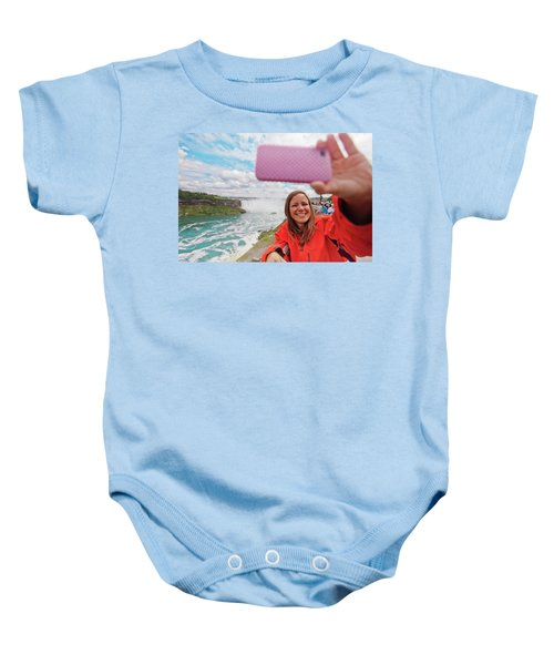 A Female Tourist Takes A Selfie With Baby Onesie