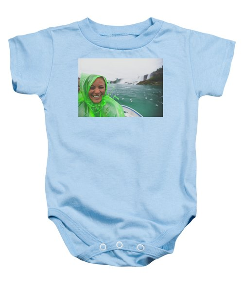 A Tourist Poses For A Picture While Baby Onesie
