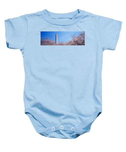 Washington Monument Behind Cherry Baby Onesie by Panoramic Images