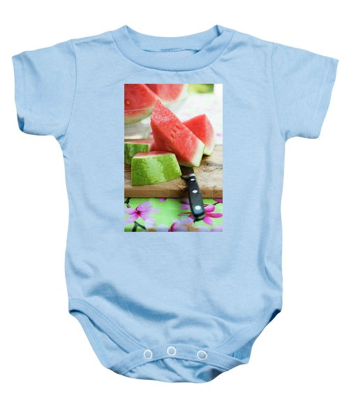 Watermelon, Cut Into Pieces, On A Wooden Board Baby Onesie