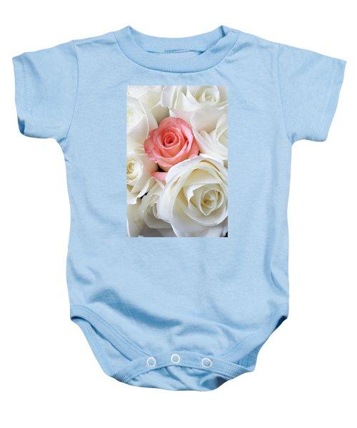 Pink Rose Among White Roses Baby Onesie