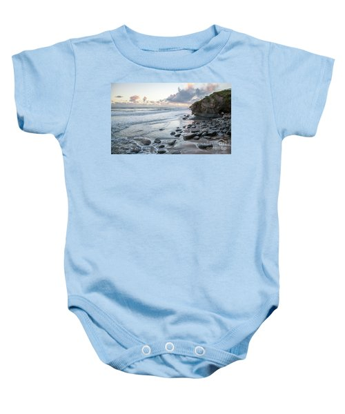 Sunset View In The Distance With Large Rocks On The Beach Baby Onesie