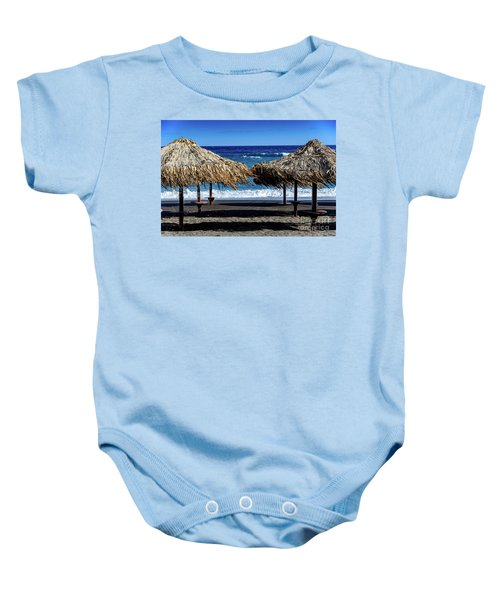Wood Thatch Umbrellas On Black Sand Beach, Perissa Beach, In Santorini, Greece Baby Onesie