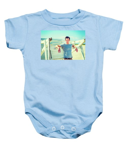 Young Man Relaxing On The Beach Baby Onesie