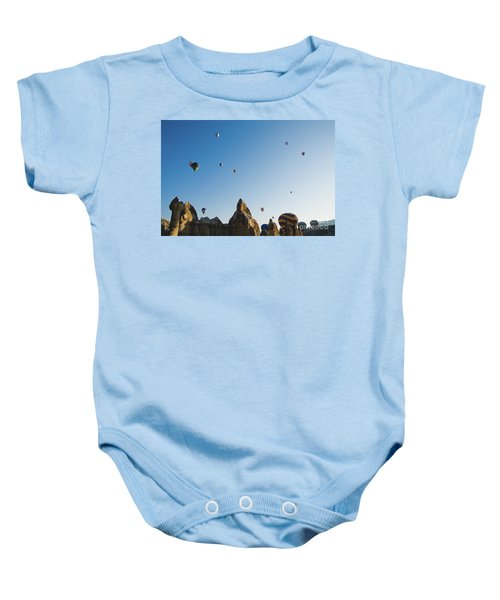 Colorful Balloons Flying Over Mountains And With Blue Sky Baby Onesie