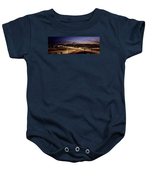 Buildings In A City Lit Up At Dusk, 7th Baby Onesie