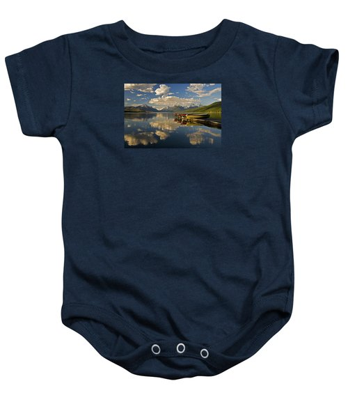 Baby Onesie featuring the photograph Boats At Lake Mcdonald by Gary Lengyel