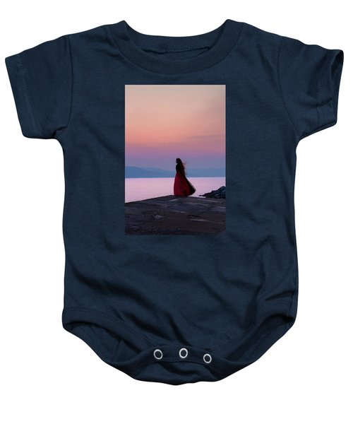 Lone Figure On The Cob, Lyme Regis, Dorset, Uk, At Sunrise. Baby Onesie