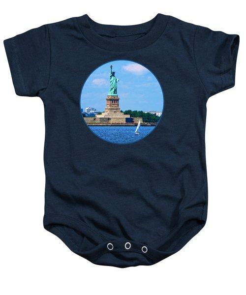 Manhattan - Sailboat By Statue Of Liberty Baby Onesie
