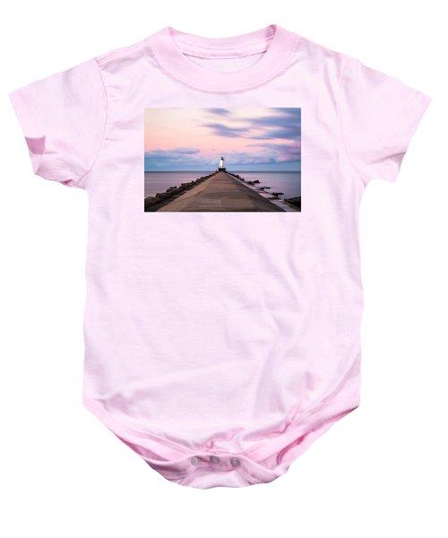 Baby Onesie featuring the photograph Ludington North Breakwater Light Sunrise by Adam Romanowicz