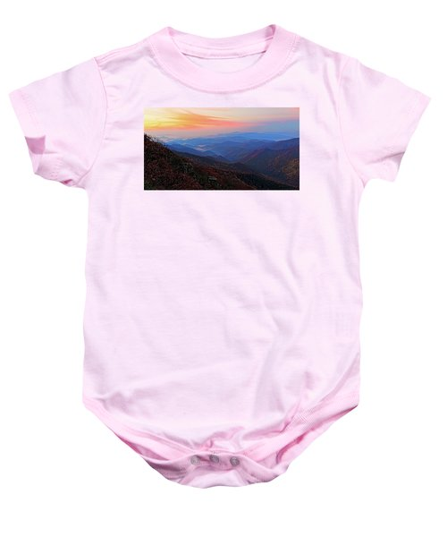 Dawn From Standing Indian Mountain Baby Onesie