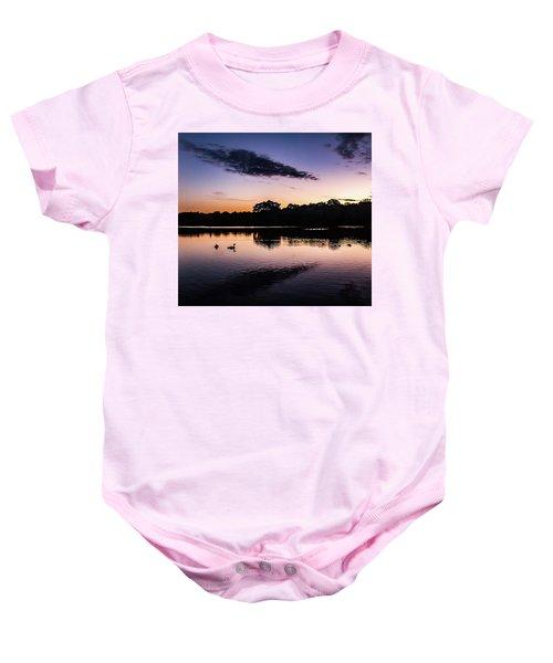 Swans At Sunrise Baby Onesie