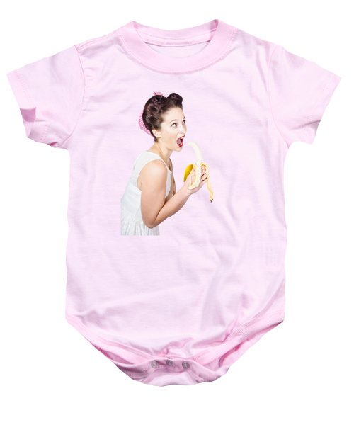 Baby Onesie featuring the photograph Pin-up Woman Eating Fruit On Studio Background by Jorgo Photography - Wall Art Gallery