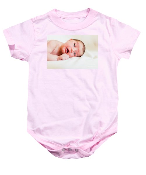 Portrait Of Newborn Baby Girl Feels Safe And Awake To A New Life. Baby Onesie