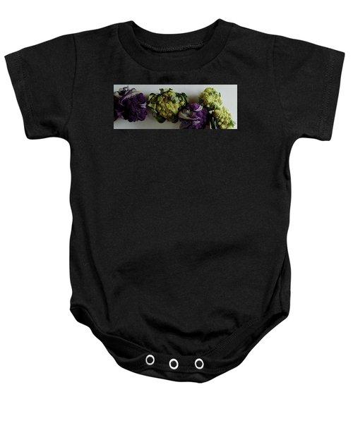 A Group Of Cauliflower Heads Baby Onesie