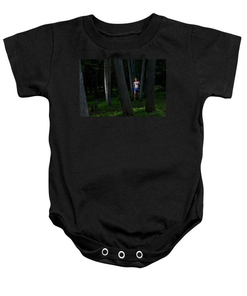 A Woman Trail Running In The Forests Baby Onesie