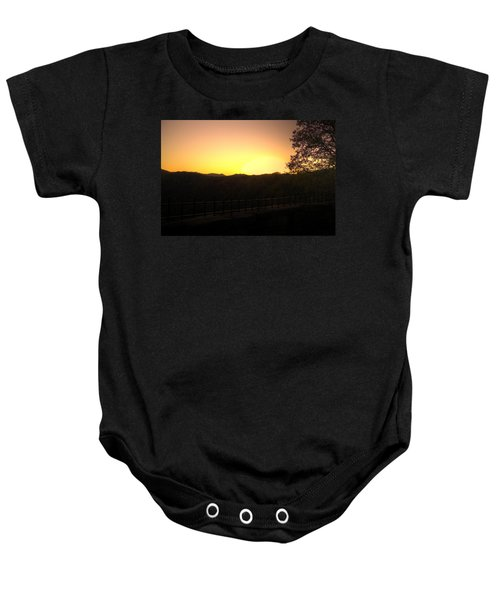 Baby Onesie featuring the photograph Sunset Behind Hills by Jonny D